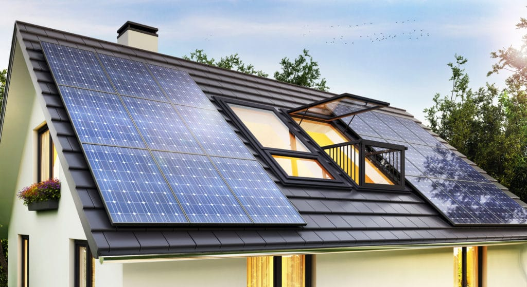 A home owned by a property manager franchisee with solar panels and eco-friendly windows.